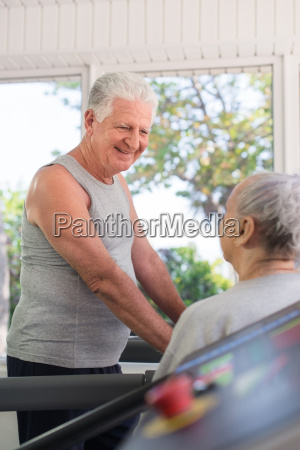 active senior friends talking and working