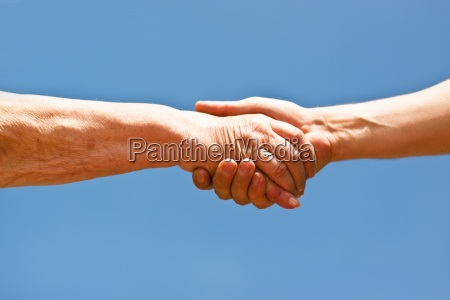 handshake of an old woman and