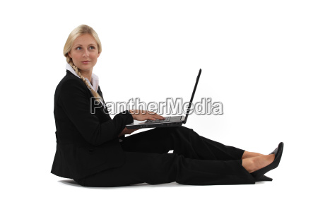 a businesswoman sitting on the floor