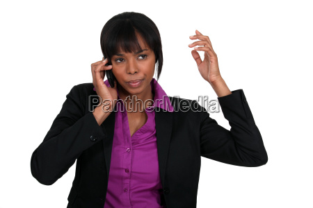 annoyed businesswoman on the phone