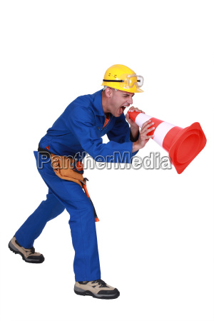 construction worker shouting into a traffic
