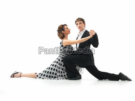 passionate dancing couple on white background