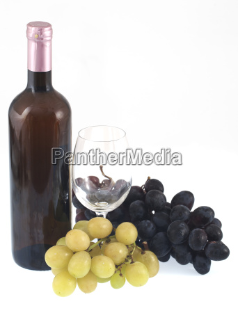 red wine bottle glass and grapes