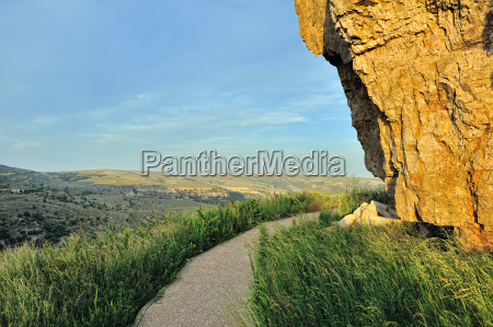 sunset landscape with big overhung rock