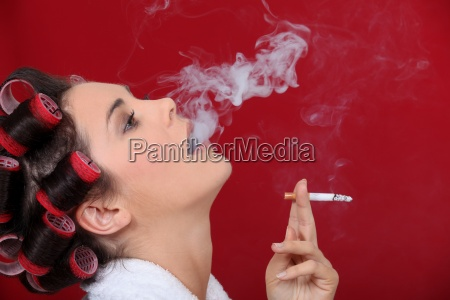 female smoker exhaling puffs of smoke