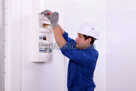 electrician working on the fuse board