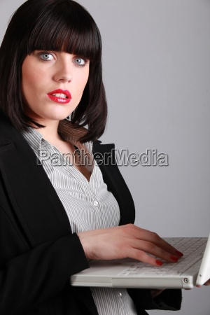 woman in red lipstick working at