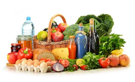 groceries in wicker basket including vegetables