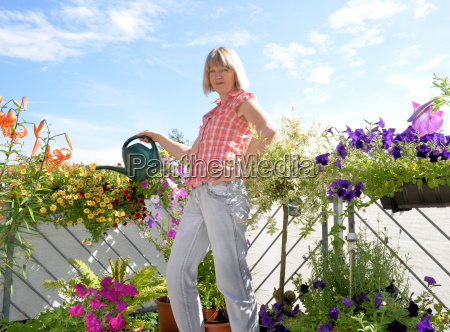 woman with balcony flowers