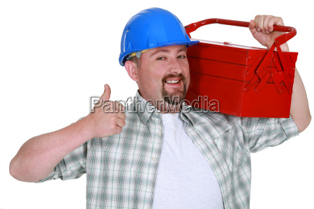 tradesman carrying a toolbox and giving