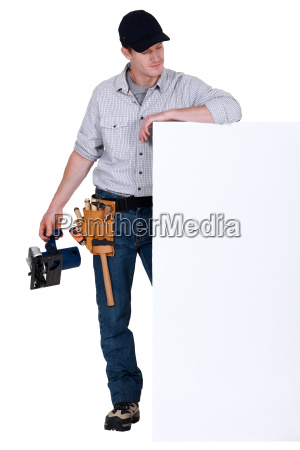 tradesman admiring a blank sign