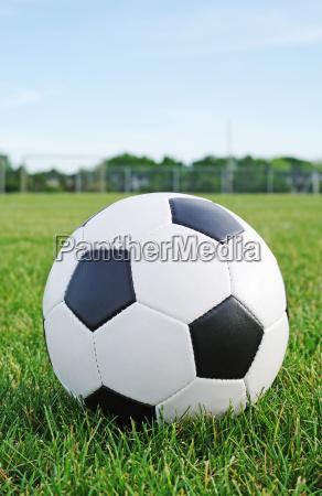 football ball in the grass field