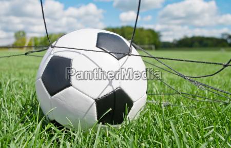 football ball in the goal against