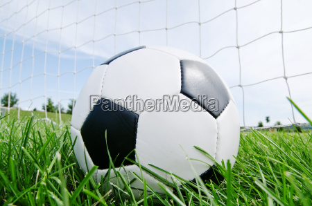 classic football in the goal net