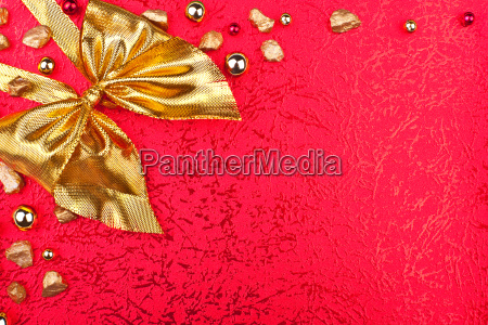 red greeting card with gold ribbon