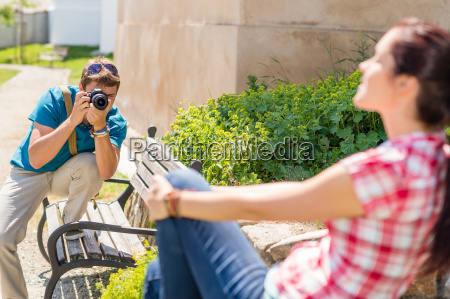 man taking pictures of woman on