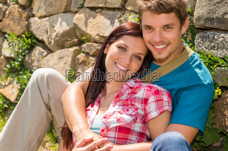 young couple in love leaning against