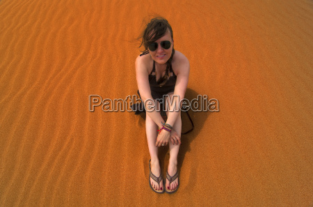 sitting in the sand