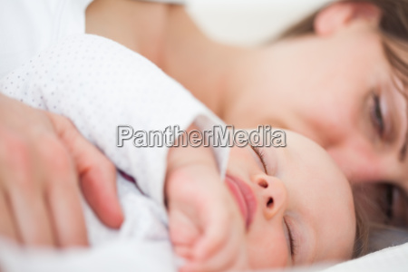 woman and her baby lying side