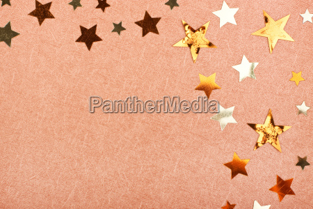 brown greeting card with shiny stars