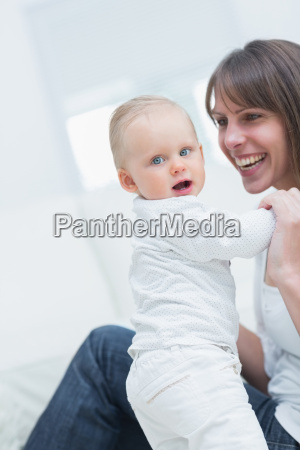 mother with a baby in living