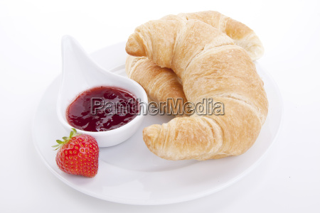 fresh croissant with earth beer jam