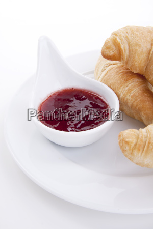 fresh croissant with strawberry jam isolated