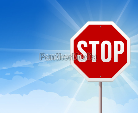 stop roadsign on blue sky background
