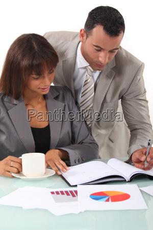 man and woman interpreting financial results