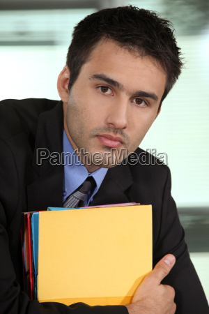 eager young businessman falling behind with