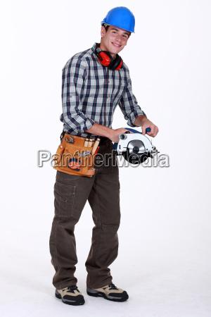 smiling carpenter with circular saw