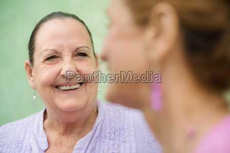 two elderly women meeting and talking