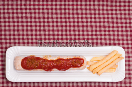 currywurst with curry sauce and fries