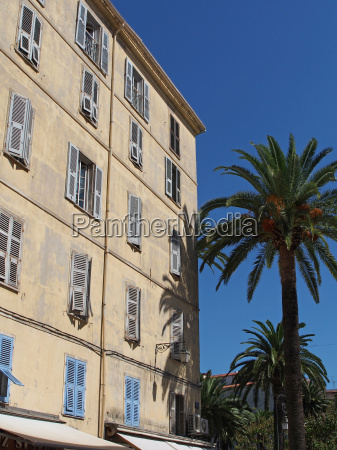 mediterranean building and palm trees
