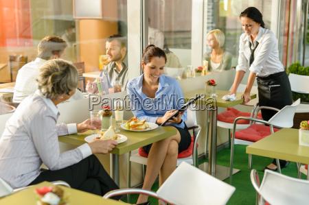 businesswomen talking business in lunch break