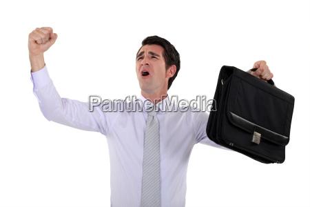 happy businessman raising hands