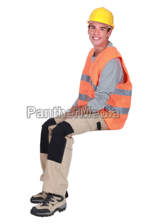 young tradesman sitting on an invisible