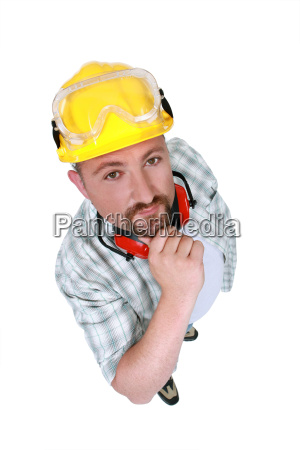 manual worker with goggles and hearing