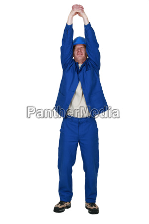 man in jumpsuit stretching his arms