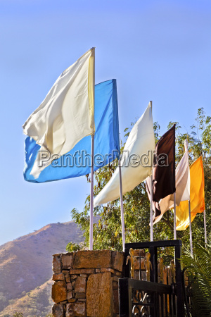 plain multi colored flags on wall