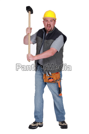 angry construction worker with sledge hammer