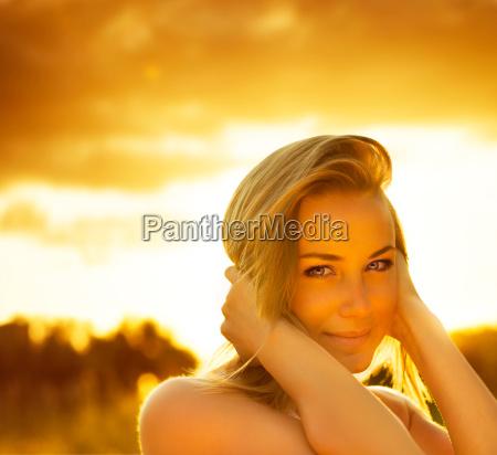 beautiful female over sunset