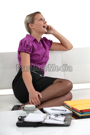 woman laughing on a phone call