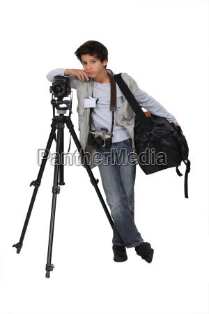 kleiner junge als reporter verkleidet