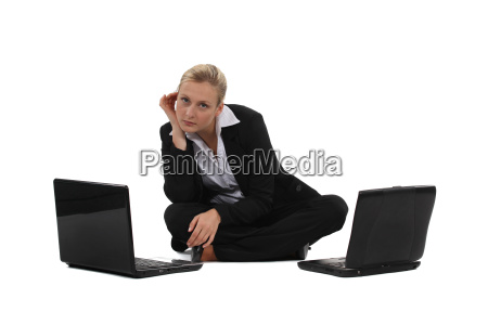 businesswoman sat on the floor with