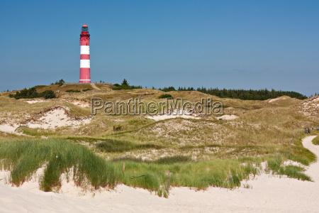 dune landscape on amrum with lighthouse