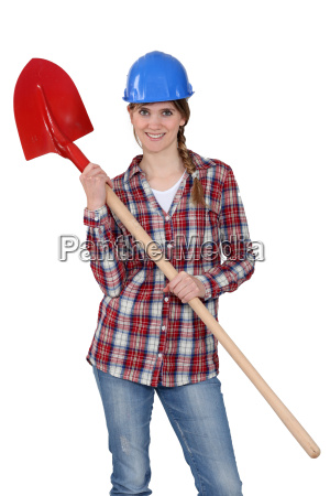woman wearing hard hat and holding