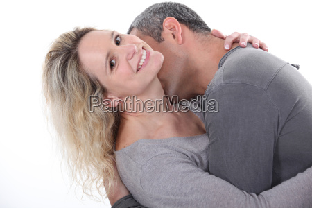 man kissing his wifes neck