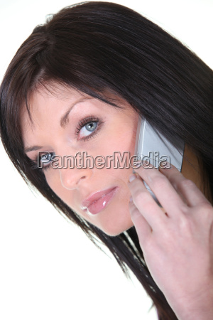 young brunette on phone on white