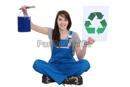 a female painter promoting recycling